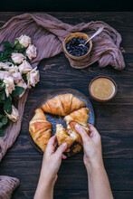 Woman Having Coffee And Croissants For Breakfast