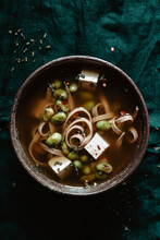Miso Soup With Tofu On A Green Napkin