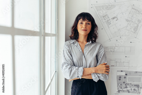 Fototapeta Confident female architect standing in office obraz