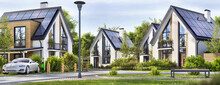 Beautiful Residential Houses With Solar Panels In A Suburban Neighborhood. Сharging For Electric Car
