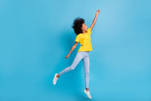Full Size Profile Side Photo Of Brunette Dark Skin Girl Jump Catch Wear Casual Outfit Isolated On Blue Color Background