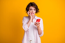 Photo Of Anxious Frightened Girl Use Smartphone Feel Fear About Social Media Feedback Comments Bite Fingers Wear Style Stylish Clothes Isolated Bright Shine Color Background