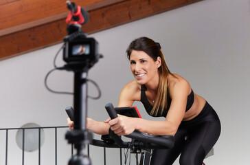 Fototapeta na wymiar Vlogger recording spinning lesson