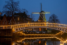 Medieval Windmill In The City Dokkum In The Netherlands In Christmas Time At Twilight