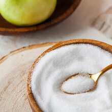 Natural Sweetener In A Wooden Bowl. Erythritol