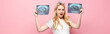shocked blonde young pregnant woman with ultrasound scan with pizza and fish on pink background, banner.
