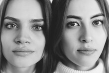 Close Up Portrait Of Beautiful Brunette Women On Studio Background, Black And White. Home Comfort, Emotions, Facial Expression, Winter Mood Concept. Friendship. Well-kept Skin, Natural Make Up.