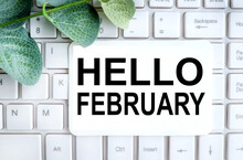 Hello February Text On White Paper On White Keyboard