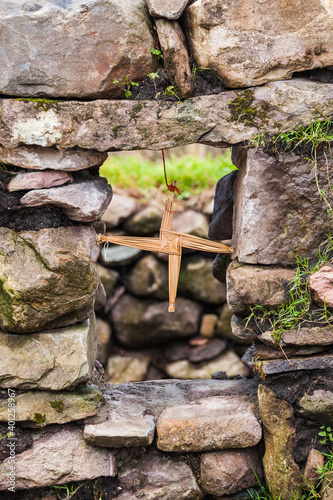 Obraz Saint Brigid's cross made from straw stuck in window and blessed the house and protected it from fire and evil. Concept: religion, irish, traditional - fototapety do salonu