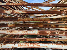 Rusting Old Pallet Racks In A Warehouse Field Rusting From Water Rain Damage