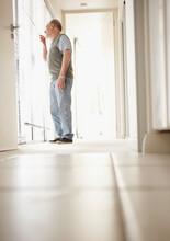 Patient Standing In Corridor Of Clinic
