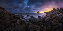 Breathtaking Panoramic View Of Shore With Boulders And Calm Sea On Background Of Sundown Sky In Iceland
