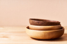 Empty Wooden Bowls Of Various Shapes On Bright Studio Background