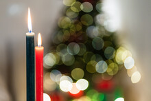Closeup Of Burning Candles In Cozy Room On Bokeh Background During Christmas Party