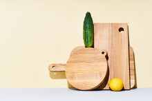 Wooden Cutting Boards Of Various Shapes On Bright Studio Background