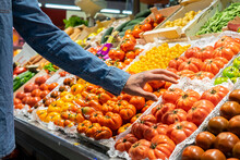 Cropped Unrecognizable Male Customer Choosing Fresh Groceries While Buying Food In Supermarket
