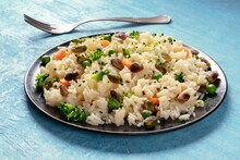 Vegan Rice With Vegetables, Healthy And Delicious, On A Blue Background