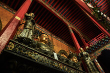 From Below Of Aged Oriental Palace With National Monuments On Metal Balcony Located Among Ornamental Roof