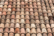 Closeup Of Weathered Rusty Red Tiles On Roof Of Medieval Building For Textured Background