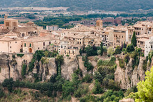 Scenic View Of Medieval Town Cuenca With Old Stone Houses Located On Hills Covered With Green Trees Under Blue Cloudy Sky In Summer Day In Spain