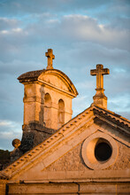 Low Angle Detail Of Medieval Stone Church Building With Crosses On Top Against Cloudy Sky In Cuenca Town In Spain