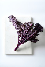 Red Kale On White Background Top View