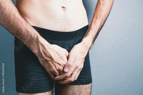 Cuadros en Lienzo man holding genitals. urological diseases, pain during urination