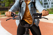 Crop Unrecognizable Ethnic Male Riding Contemporary Bike Along Street In City