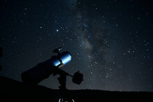 Modern Optical Telescope Against Cloudless Dark Sky With Glowing Stars At Night Time