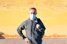 Portrait Of Senior Retired Man With Face Mask And Sportswear