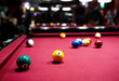 Leinwandbild Motiv group of snooker multicolored balls lays on the table. Closeup view. Billiard red table with cue and balls. Leisure, hobby and entertainment concept