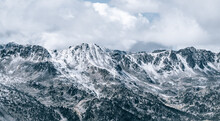 Majestic Panoramic Scenery Of Rough Rocky Slopes Of Pyrenees Mountain Range Covered With Snow Under Cloudy Sky In El Pas De La Casa