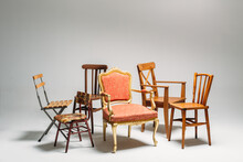 Studio Shot Of Classical Mixed Chairs On Neutral Background