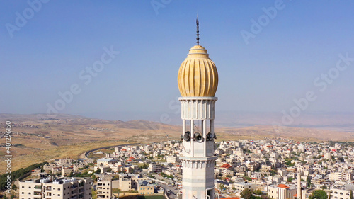 Fotografia, Obraz Mosque Tower minaret With Speakers in Jerusalem Beautiful Drone footage with Jor