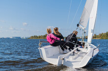 Dad And His Two Daughters Went Out On A Yacht On The River To Sail Along The City, And Teach The Girls To Conduct A Sports Yacht