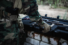 Military Man Preparing Equipment Of Firearms To The Mission. Pulls Out Assault Rifle From The Ammunition Case.