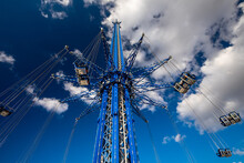 Orlando, Florida, US - February 2019: Orlando Starflyer Is The Tallest Swing Ride Standing At 450 Feet. All Double Seats Are Empty On This Safety Test Run. The Structure Is Blue With Silver Seats.
