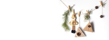 Decorative Decoration For Christmas And New Year. Gifts, A Toy Snowman, Pine Branches, Cones Are Attached To The Rope With Clothespins. Eco-friendly Holiday Concept.