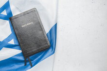 Holy Bible And Flag Of Israel On Light Background