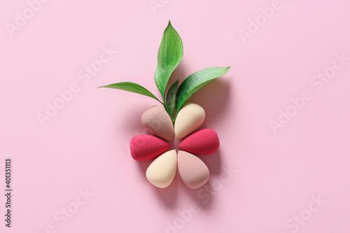 Fotografía Flower made of makeup sponges on color background