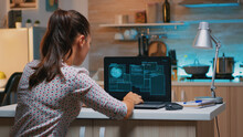 Woman Hacker Coding Html And Programming On Screen Laptop Working From Home In Midnight. Programmer Writing A Dangerous Malware For Cyber Attacks Using Performance Device During Midnight.