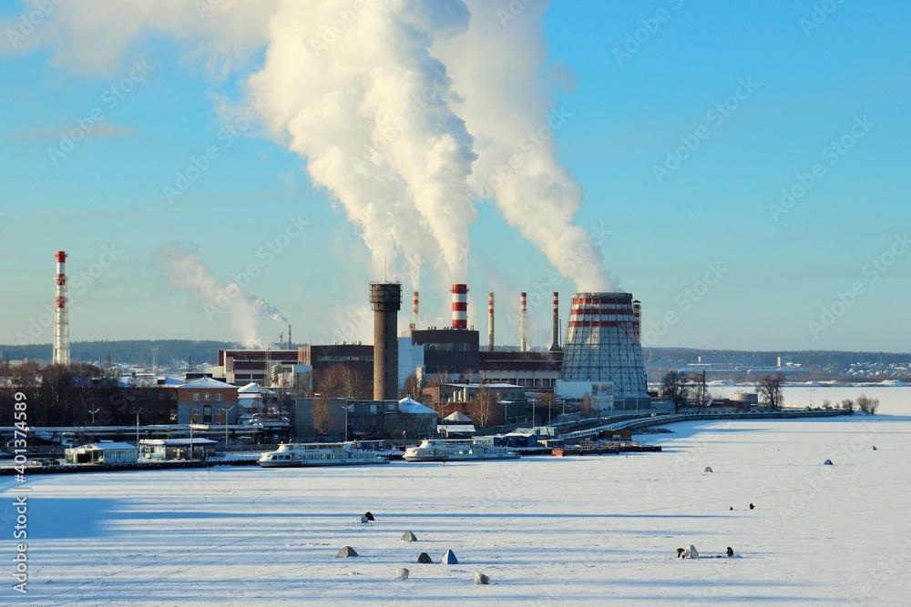 Fototapeta Man-made landscape, winter clear day smoking factory chimneys