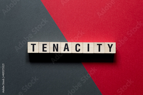 Foto Tenacity word concept on cubes