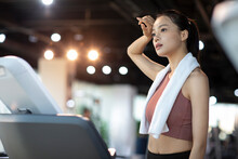 Young Woman Taking A Break From Workout At Gym
