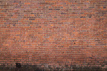 Brick Wall With Red Brick, Red Brick Background.Grungy Old Red Brick Wall Texture Background With Deterioration From Age.Red Brick Wall. Photo Grunge Background. Rustic Style Background. Background