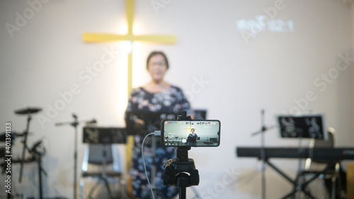 Fotografie, Obraz Church services online with new normal concept, Online preach with smartphone