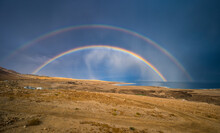 Beautiful Israeli Landscape: Rainbow In The Clouds Over The Dead Sea, The Lowest Place On Earth, Its North-western Shore Covered In Sinkholes