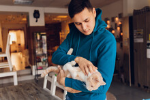 Young Man Holding A White Cat Close-up.