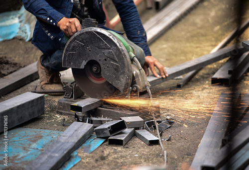 Tela Mechanic is cutting steel metal with rotating steel cutter machine and Sparks fl