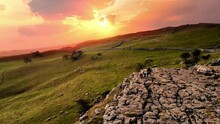 Sunset Drone Shot Flying Over Drummer Playing On Rocks At Malham Cove